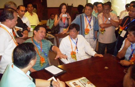 HARASSMENT: Abono Partylist  Chair Rosendo O. So  (3rd from left) defends  Agriculture Secretary Proceso J. Alcala (4th from left) on the plunder case  he dubbed as harassment filed recently by activist lawyer Argee Guevarra on Alcala's alleged involvement on the padding of prices of imported rice from Vietnam.