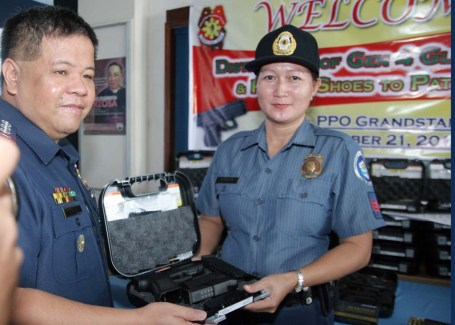 Police Senior Supt.Marlou Chan(left), Pangasinan PNP director, leads in the distribution of the 399 units of Glock pistols last October 21 at the Pangasinan PNP provincial office in Lingayen. The 399 is the first tranche of the distribution as they will also distribute another 336 units this week. Priority for the Glock firearms are PO1s to PO3s without issued firearms and those who passed the proficiency on Glock pistol. Patrol shoes were also distributed.CESAR RAMIREZ