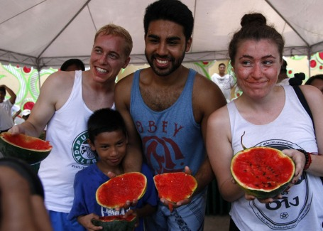 Foreign tourists(from left) Julian Lauber from Germany; Canadian Joseph Johnson; and Kate Heinrich also from Germany, and a young Filipno participant  are all smiles after they gamely joined the watermelon eating contest during the 1st Pakwan Festival in Bani town last February 8. The town is known for its sweet watermelon.CESAR RAMIREZ