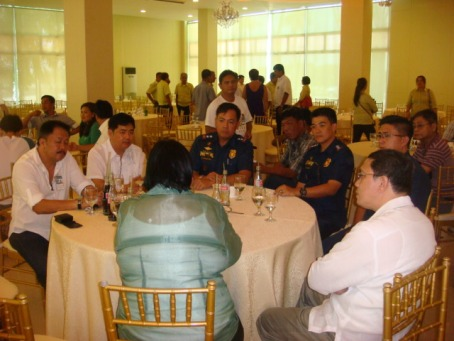 TOP BRASS AT SOCA.  Dagupan City Mayor Belen T. Fernandez exchanges pleasantries with officials of of the Pangasinan's Police Provincial Office headed by acting Provincial Director Senior Superintendent Raymond Sterling Blanco (3rd from right),  and National Bureau of Investigation – Pangasinan led by its chief lawyer Pedro Roque (2nd from Left) after she delivered the 2014 State of the City Address (SOCA) held at her family owned Stadia  last  May 22. MORTZ C. ORTIGOZA