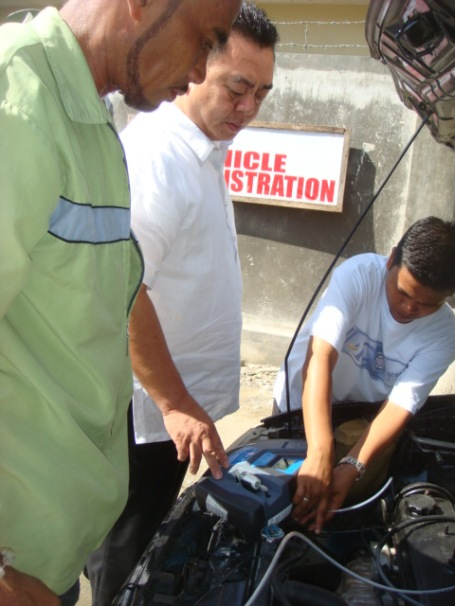 ANTI- ENVIRONMENT FREON  Richard Agbayani (center), Assistant Head  of Land Transportation Office in Dagupan City, leads his men in operating the refrigerant identifier gadget that could determine if a vehicle being registered or renewing registration still used the banned Chlorofluorocarbon-12, also known as R-12 Freon system. Agbayani said the full implementation of converting vehicles' air-conditioning system from the anti-environment R-12 to the environmentally friendly R134a started in 2012. MORTZ C. ORTIGOZA