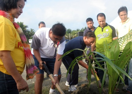 Pangasinan 2nd district Rep. Leopoldo Bataoil(in blue shirt and pants) joins officials from the Parole and Probation Administration-Department of Justice(PPA-DOJ) and from the provincial government in a tree planting at the side of baywalk at the Capitol Beachfront in Lingayen last July 25. The activity is part of the 38th PPA-DOJ anniversary and 21st Probation Week.CESAR RAMIREZ