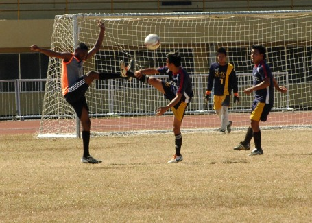 A player from African team and a Nueva Ecija player kick the ball in this bit of action during the 1st Gov.Amado Espino Jr. Football Cup at the Narciso Ramos Sports and Civic Center(NRSCC) in Lingayen. The sports event is sponsored by the provincial government in cooperation with the JCI Lingayen Bagoong and the Lingayen Football Club(LFC).CESAR RAMIREZ