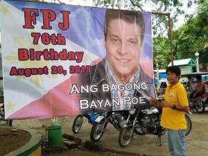 IDOL. This man makes the thumbs up sign in front of a tarpaulin featuring the late movie actor Fernando Poe Jr. who would have turned 76 last August 20.