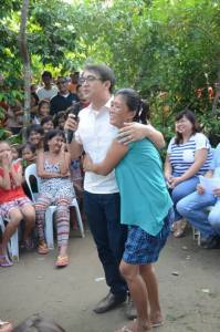 "ONE IN A MILLION. A supporter hugs Calasiao Mayor Mark Roy Macanlalay when he mimicked  Larry Graham's musical opus ""One in a Million"" in one of the powwows in the huge Pangasinan province. Macanlalay eyes the vice gubernatorial post in the Northern Luzon province.  LOEJAN ANUDON"