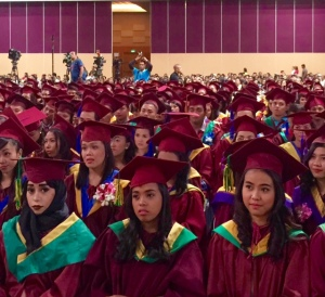 GRADUATES OF UL. The graduates of University of Luzon listen attentively to the message of presidential aspirant Senator Grace Poe during their commencement exercises at the CSI Stadia Dagupan last November 11.